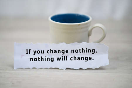 Photo for Inspirational quote - If you change nothing, nothing will change. A paper note reminder with motivational text message on it on white table background. - Royalty Free Image