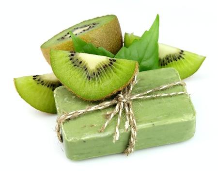 Soap with fresh kiwi on the white