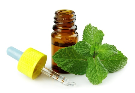 bottle of peppermint oil and fresh min