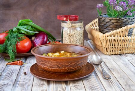 Photo pour Traditional Georgian Kharcho soup with meat and rice on old wooden background. - image libre de droit
