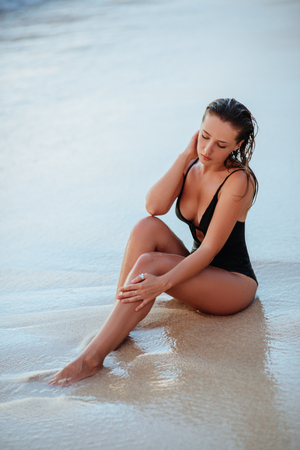Photo for Beautiful and fashion young woman posing at beach. - Royalty Free Image