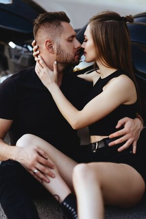 Photo for Couple of lovers kissing and hugging on motorbike - Royalty Free Image