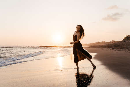 Photo for Smile Freedom and happiness chinese woman on beach. - Royalty Free Image