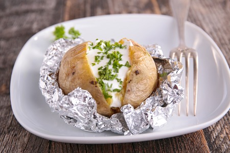 baked potato with cream and chives
