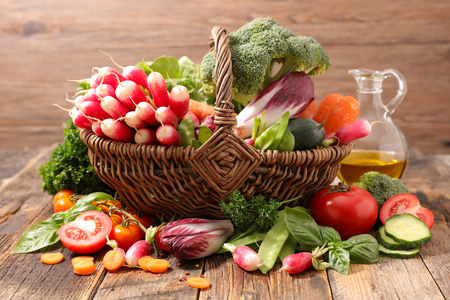 wicker basket with vegetablesの写真素材