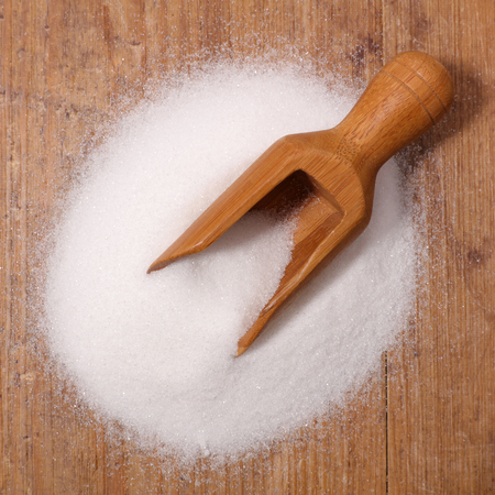 sugar on wood background