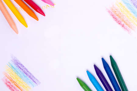 Photo for Chalks of different colors on a white paper. Copy space - Royalty Free Image