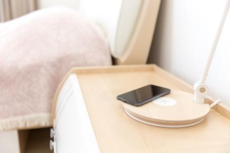 Wireless telephone charging in bedroom