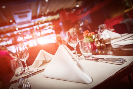 Photo pour Fine table setting with red light flare - image libre de droit