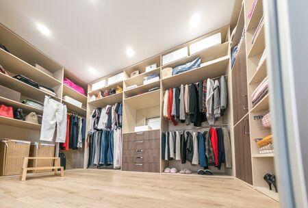 Photo pour Big wardrobe with different clothes for dressing room - image libre de droit