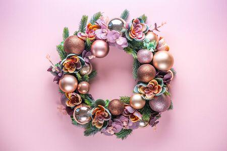 Photo pour Beautiful unusual Christmas wreath decoration on pink background. flat lay - image libre de droit