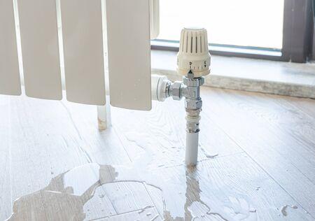 Foto de water leak through the heating radiator tube nut - Imagen libre de derechos