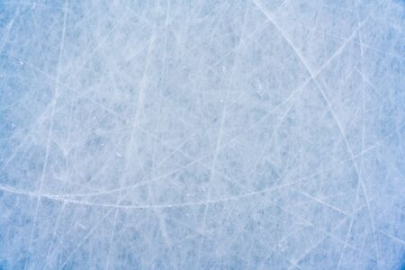 Foto de Ice background with marks from skating and hockey, blue texture of rink surface with scratches - Imagen libre de derechos