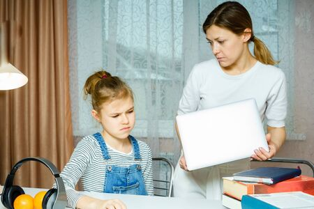 Photo pour Mother Arguing With Teenage Daughter Over Online Activity taking away laptop - image libre de droit