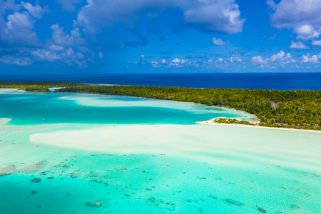 French Polynesia Tahiti aerial drone view of Fakarava atoll and famous Blue Lagoon and motu island with perfect beach, coral reef and Pacific Ocean. Tropical travel paradise in Tuamotus Islands.