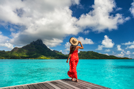 Photo pour Bora Bora island luxury resort hotel woman relaxing at view of Mt Otemanu in Tahiti, French Polynesia Honeymoon travel destination for summer vacation. - image libre de droit
