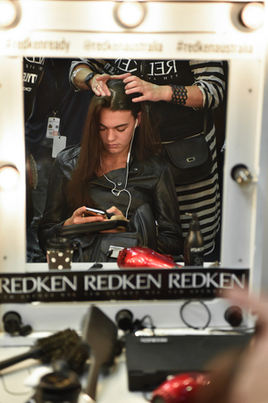 SYDNEY / AUSTRALIA - 20 May: Model is getting ready and being done a hair by a hair stylist for show before House of Cannon fashiob show at Mercedes Benz Fashion Week Australia on 20 May 2016 in Carriageworks Sydney