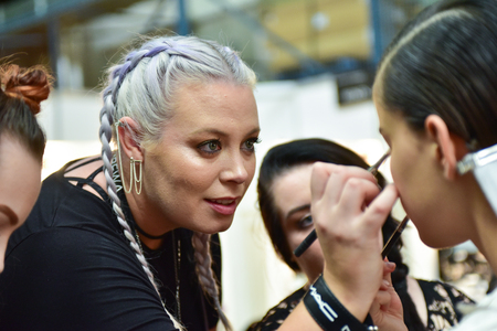 SYDNEY / AUSTRALIA - 20 May: Model is getting ready and being applied a makeup by a makeup artist for show before House of Cannon fashiob show at Mercedes Benz Fashion Week Australia on 20 May 2016 in Carriageworks Sydney