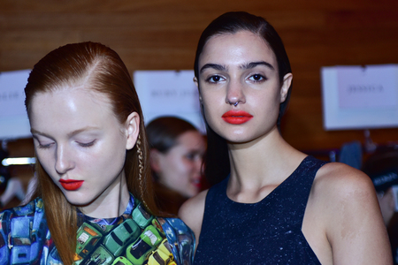 SYDNEY / AUSTRALIA - 20 May: A couple of models get ready at backstage of House of Cannon fashiob show at Mercedes Benz Fashion Week Australia on 20 May 2016 in Carriageworks Sydney