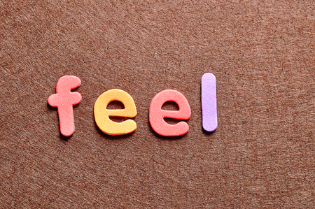 The word feel on a brown background