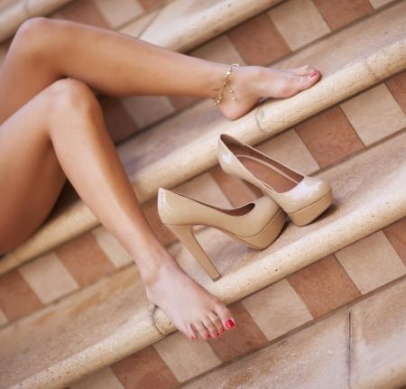 Photo pour Woman's legs with high hill shoes - image libre de droit