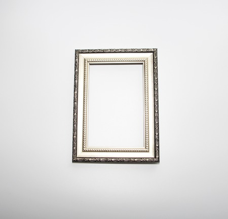 Aged frame for a photo, picture or certificate. Photo on a white background. There is nothing in the frame.