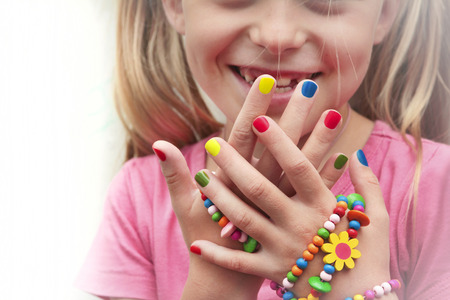 Photo pour Children's multicolored manicure with ornaments on a hand. - image libre de droit
