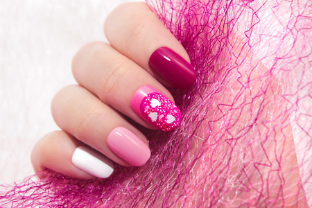 Pink cherry nail design for nail glitter different shapes closeup.