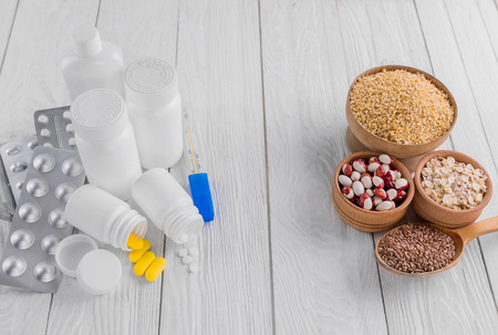Pills or healthy eating choice. Healthy diet concept. Set of pills and cereals.