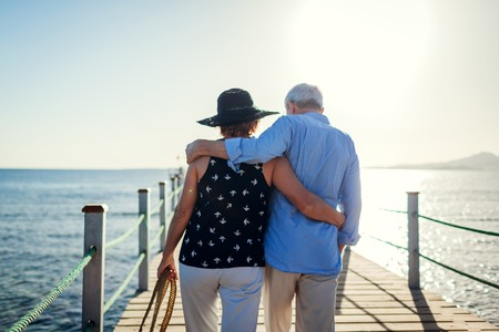 Photo pour Senior couple walking on pier by Red sea. People enjoying vacation. Valentines day - image libre de droit