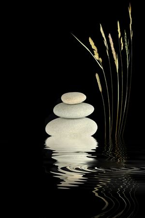 Zen abstract of wild grass and grey stones with reflection over rippled water, over black background.