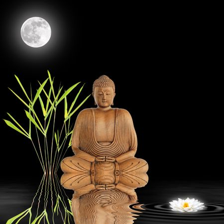 Zen abstract of a buddha in contemplation with bamboo leaf grass and  white japanese lotus lily with reflection in rippled water. Over black background with a full glowing moon.