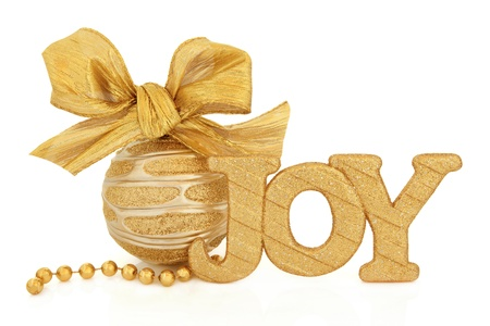 Christmas joy glitter sign, gold and silver bauble with bow and bead chain over white background