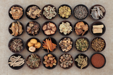 Large traditional chinese herbal medicine selection in wooden bowls