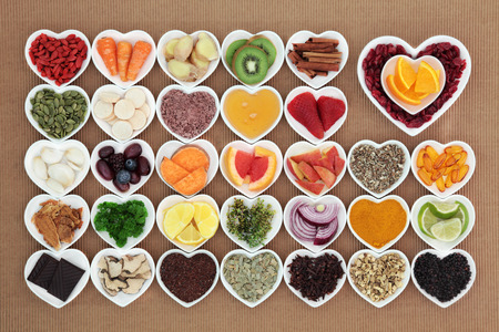 Foto für Health food for flu and cold remedy cures high in antioxidants and vitamin c with tablets, medicinal herbs and spices in heart shaped dishes. - Lizenzfreies Bild