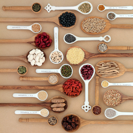 Foto für Dried superfood selection in spoons and bowls over natural paper background. Highly nutritious in antioxidants, minerals, vitamins and dietary fiber. - Lizenzfreies Bild