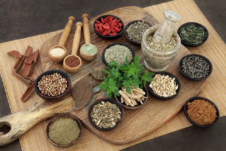Photo pour Herb and spice health food selection for men in wooden bowls and spoons. Used in natural alternative herbal medicine. - image libre de droit