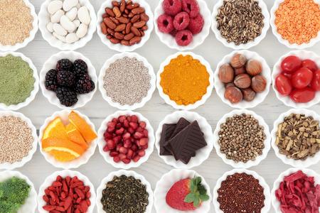 Foto für Super health food selection in porcelain crinkle bowls over distressed wooden background. High in vitamins and antioxidants. - Lizenzfreies Bild