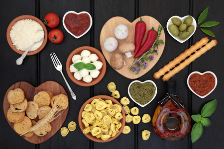 Mediterranean healthy diet food selection over dark wood background.
