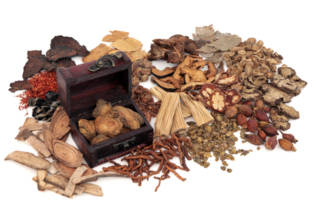 Photo pour Chinese herb ingredients used in traditional herbal medicine with an old box over white background. - image libre de droit