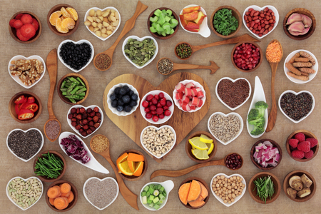 Healthy super food  selection in wooden and porcelain china bowls and spoons. High in antioxidants, vitamins, minerals and anthocyanins.