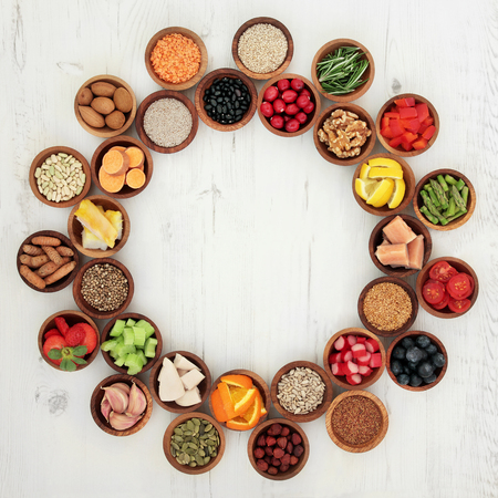 Foto für Healthy super food selection in wooden bowls forming a wheel over distressed whte wood background. High in antioxidants, vitamins, minerals and anthocyanins. - Lizenzfreies Bild