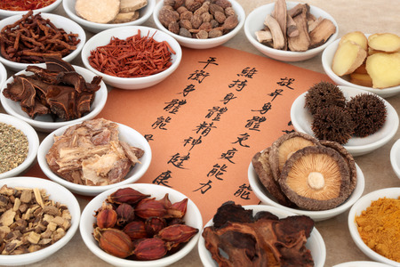 Photo pour Traditional chinese herb selection used in herbal medicine in porcelain bowls with calligraphy script. Translation describes the medicinal functions to maintain body and spirit health and balance energy. - image libre de droit