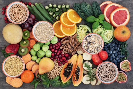 Photo for Health food concept for a high fiber diet with fruit, vegetables, cereals, whole wheat pasta, grains, legumes and herbs. Foods high in anthocyanins, antioxidants, smart carbohydrates and vitamins on marble background top view. - Royalty Free Image