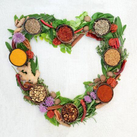 Photo pour Heart shaped herb leaf and spice wreath - image libre de droit