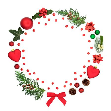 Photo for Abstract christmas wreath decoration with baubles, winter flora, loose berries and symbols on white background with copy space. Festive concept for the holiday season. - Royalty Free Image