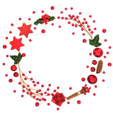 Photo for Abstract Christmas & winter wreath decoration with red bauble decorations, berry sprays, holly & winter flora on white background with copy space. Decorative symbol for the festive season. - Royalty Free Image