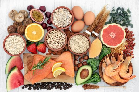 Photo pour High energy health food for vitality & fitness with fish, fruit, vegetables, cereals, pasta, grain, nuts & herbs. High in vitamins, minerals, antioxidants, smart carbs, protein & omega 3. Flat lay. - image libre de droit