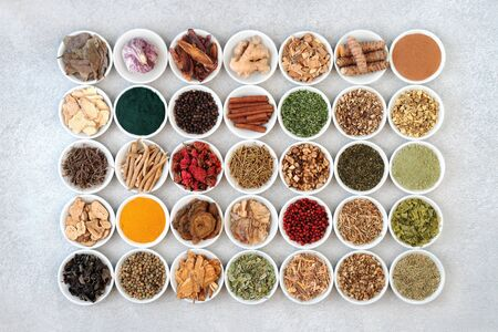 Photo pour Super food collection for health, fitness and vitality in porcelain bowls including dietary supplement powders and herbs and spice used in natural and chinese herbal medicine. Flat lay. - image libre de droit