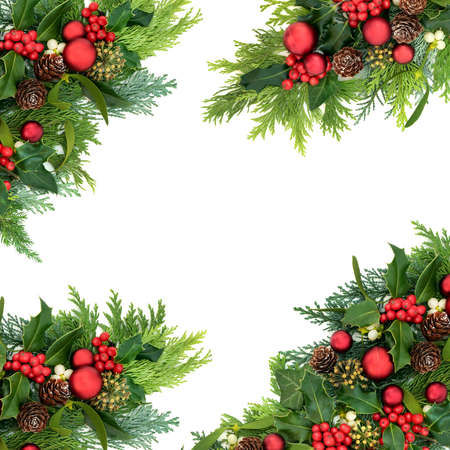Photo pour Christmas abstract border for the festive season with red bauble decorations & winter greenery of holly, ivy, mistletoe, cedar cypress & pine cones on white background. Top view, flat lay, copy space. - image libre de droit